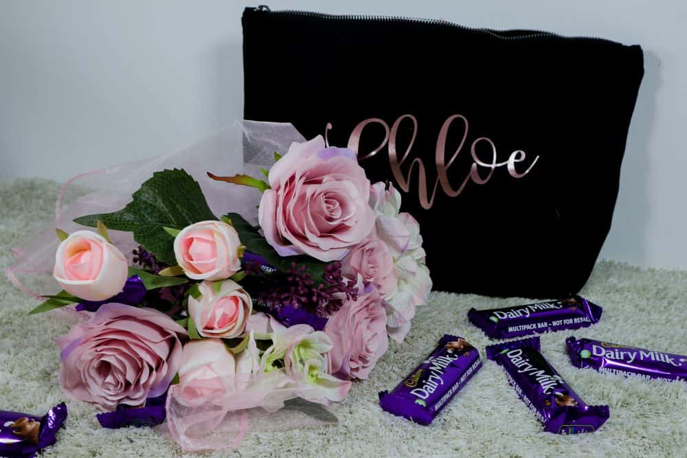 Unique gift for women. Flowers & Chocolates & Make-up Bag